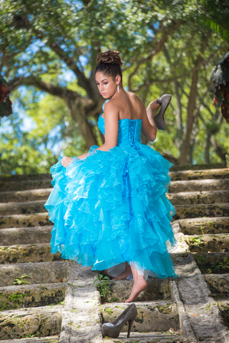 Quinceañera losing a shoe like Cinderella by stairs