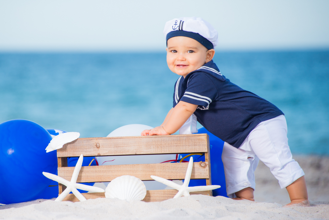 baby boy dressed as marine at the beach