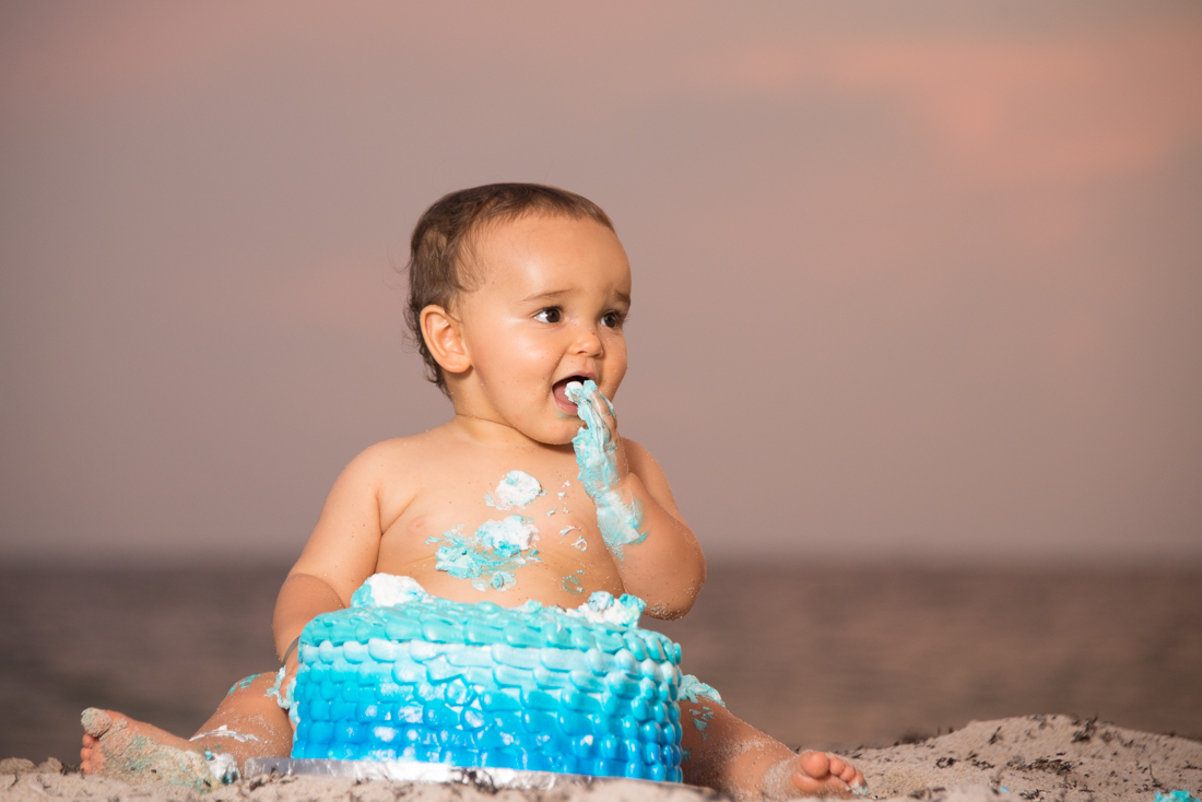 baby boy first year smash the cake picture at the beach